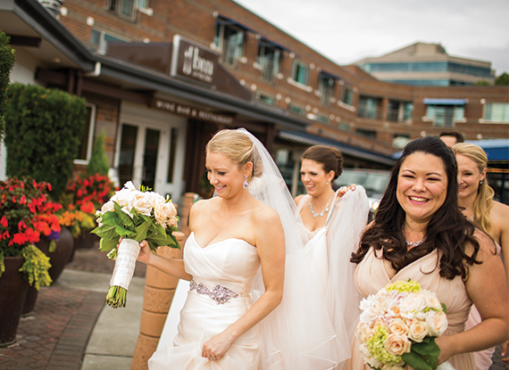 Bride And Bridesmaids At The Woodmark Hotel Overlooking Lake Washington