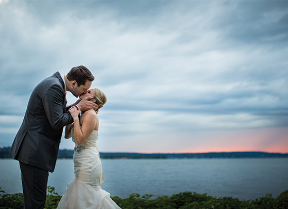 Bride and Groom Kissing on the dock on Lake Washington by the Woodmark Hotel