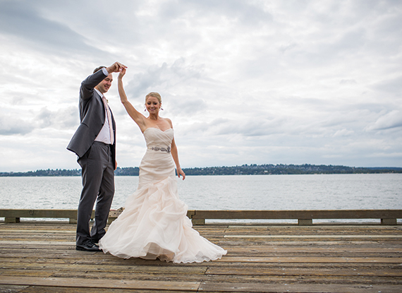 Bride and Groom on the dock on Lake Washington by the Woodmark Hotel