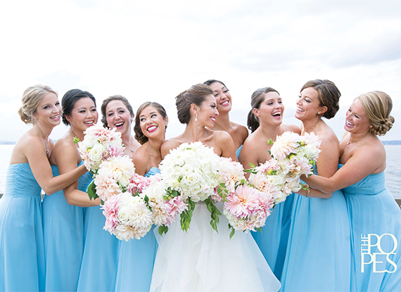 Beach Wedding Bridesmaids with Flowers Overlooking Lake Washington at The Woodmark Hotel